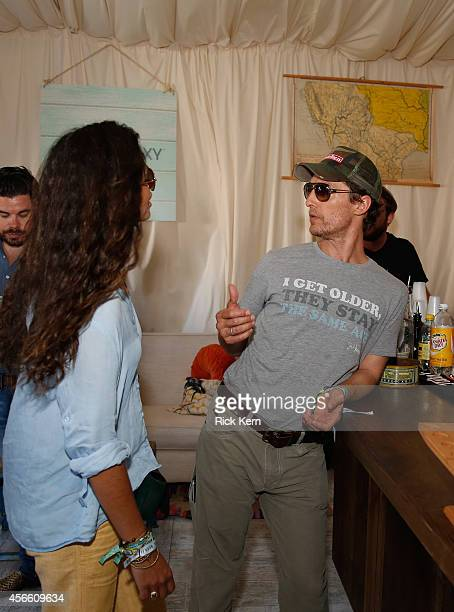 Model Camila Alves and Matthew McConaughey wearing a shirt with a quote from 'Dazed and Confused' attend the Samsung Galaxy Artist's Lounge at the...