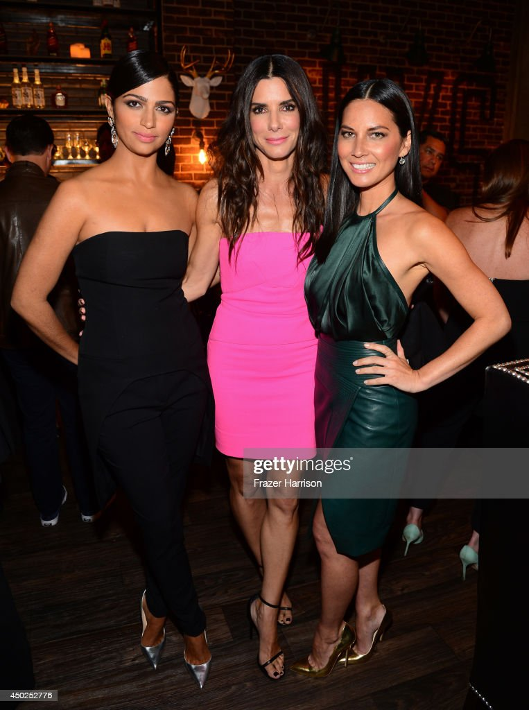 Model Camila Alves with actresses Sandra Bullock and Olivia Munn attend Spike TV's 'Guys Choice 2014' at Sony Pictures Studios on June 7, 2014 in Culver City, California.