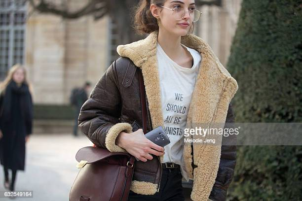 Model Camille Hurel wears oversized glasses and a 'We Should All Be Feminist' Dior shirt at the Dior Couture show at Musee Rodin on January 23 2017...