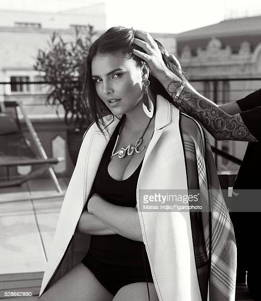 Model Candice Huffine is photographed for Madame Figaro on December 26 2015 in Paris France Coat tank top underwear earrings necklace PUBLISHED IMAGE...