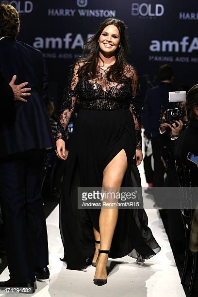 Model Candice Huffine walks during the fashion show runway during amfAR's 22nd Cinema Against AIDS Gala Presented By Bold Films And Harry Winston at...