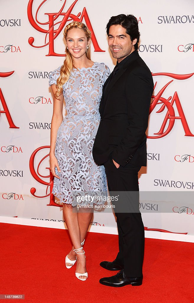 Model <a gi-track='captionPersonalityLinkClicked' href=/galleries/search?phrase=Candice+Swanepoel&family=editorial&specificpeople=4357958 ng-click='$event.stopPropagation()'>Candice Swanepoel</a> and designer Brian Atwood attend the 2012 CFDA Fashion Awards at Alice Tully Hall on June 4, 2012 in New York City.