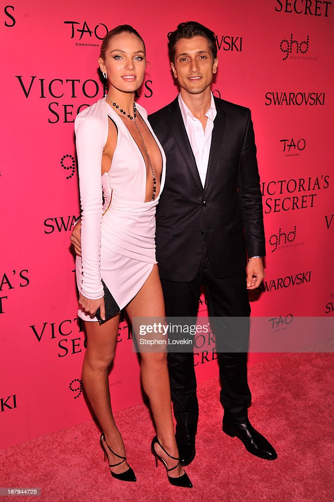 Model Candice Swanepoel and Hermann Nicoli attend the 2013 Victoria's Secret Fashion Show at TAO Downtown on November 13, 2013 in New York City.