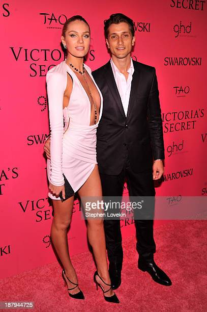 Model Candice Swanepoel and Hermann Nicoli attend the 2013 Victoria's Secret Fashion Show at TAO Downtown on November 13 2013 in New York City