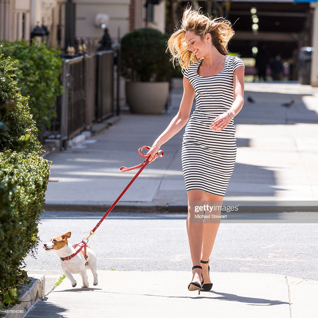 Model Candice Swanepoel is seen with her dog Milo on the set of a Victoria's Secret photo shoot on April 25, 2013 in New York City.