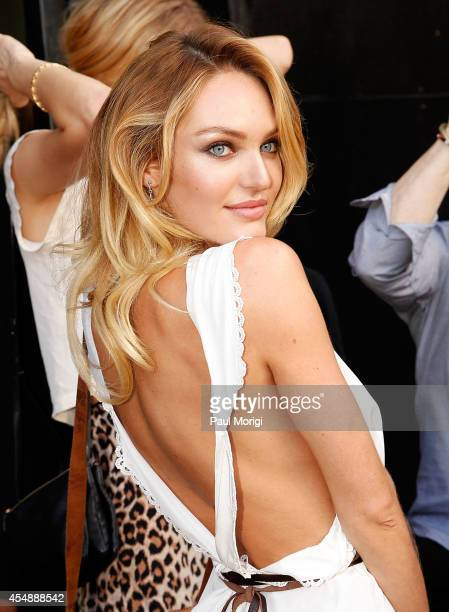 Model Candice Swanepoel poses for a photo as she leaves the Diane Von Furstenberg fashion show during MercedesBenz Fashion Week Spring 2015 at Spring...