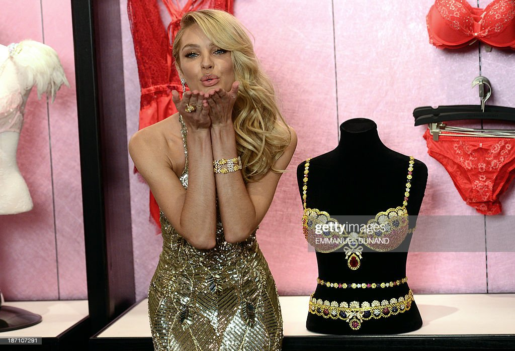 Model Candice Swanepoel poses next to Victorias Secret Royal Fantasy Bra Gift Set, which is valued at 10 million USD, in New York, on November 6, 2013. The Royal Fantasy Bra Gift Set includes a custom Dream Angels Demi silhouette bra and matching belt adorned with over 4,200 precious gems handset with rubies, diamonds, blue and yellow sapphires all set in 18 karat gold. The bra features a pear shaped center ruby weighing 52 carats. Swanepoel will be wearing the bra on the runway at the 2013 Victorias Secret Fashion show on November 13, 2013. AFP PHOTO/EMMANUEL DUNAND