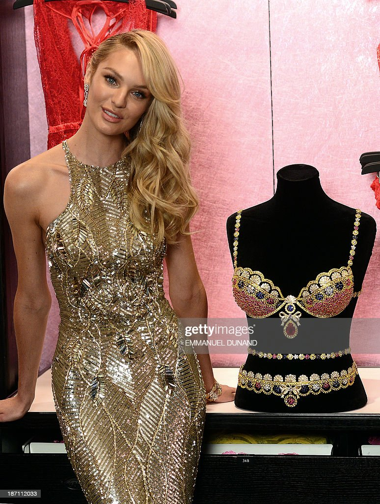 Model Candice Swanepoel poses next to Victorias Secret Royal Fantasy Bra Gift Set, which is valued at 10 million USD, in New York, November 6, 2013. The Royal Fantasy Bra Gift Set includes a custom Dream Angels Demi silhouette bra and matching belt adorned with over 4,200 precious gems handset with rubies, diamonds, blue and yellow sapphires all set in 18 karat gold. The bra features a pear shaped center ruby weighing 52 carats. Swanepoel will be wearing the bra on the runway at the 2013 Victorias Secret Fashion show on November 13, 2013. AFP PHOTO/EMMANUEL DUNAND