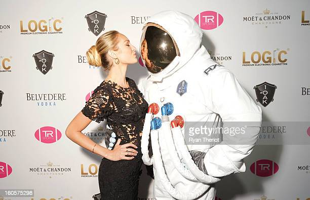 Model Candice Swanepoel poses with an AXE astronaut at 1 OAK New Orleans Presented By LOGIC Electronic Cigarettes at Jax Brewery on February 2 2013...