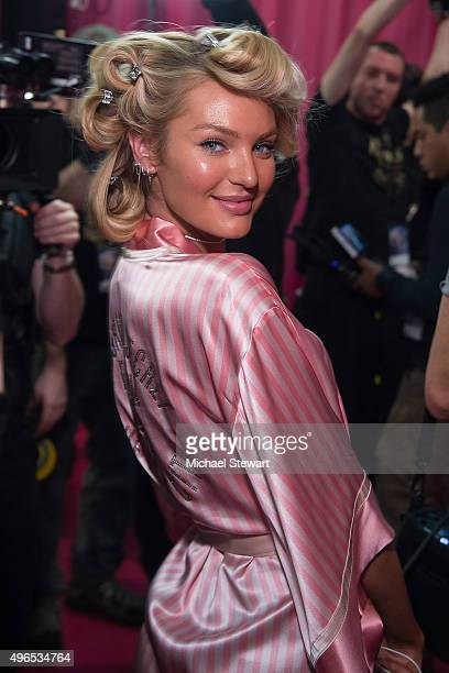 Model Candice Swanepoel prepares backstage before the 2015 Victoria's Secret Fashion Show at Lexington Armory on November 10 2015 in New York City