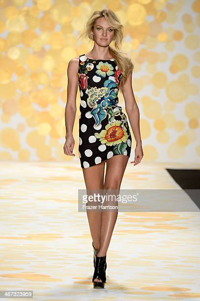 Model Candice Swanepoel walks the runway at Desigual fashion show during MercedesBenz Fashion Week Fall 2014 at The Theatre at Lincoln Center on...