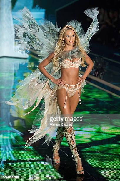 Model Candice Swanepoel walks the runway at the annual Victoria's Secret fashion show at Earls Court on December 2 2014 in London England