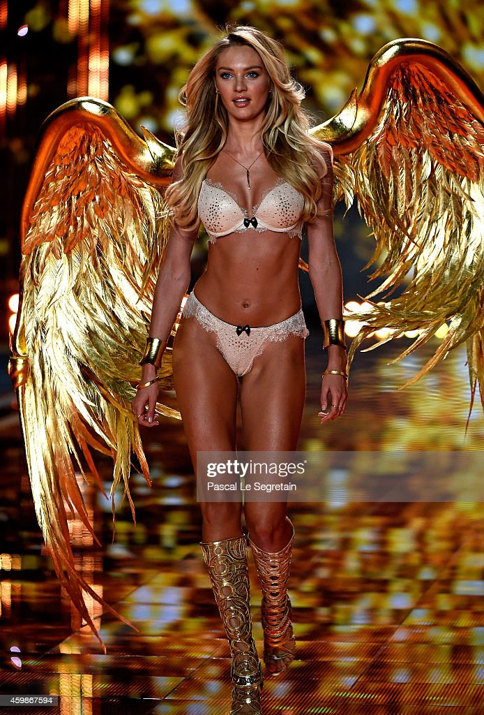 Model Candice Swanepoel walks the runway at the annual Victoria's Secret fashion show at Earls Court on December 2, 2014 in London, England.