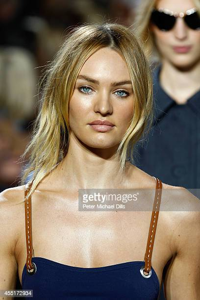 Model Candice Swanepoel walks the runway at the Michael Kors fashion show during MercedesBenz Fashion Week Spring 2015 at Spring Studios on September...