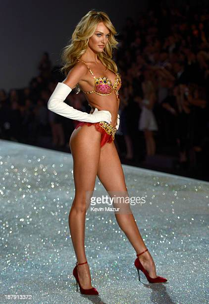 Model Candice Swanepoel wearing the Royal Fantasy Bra and Belt walks the runway at the 2013 Victoria's Secret Fashion Show at Lexington Avenue Armory...