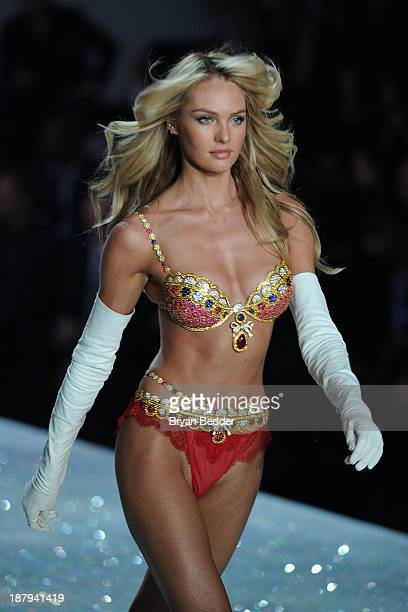Model Candice Swanepoel wearing the Royal Fantasy Bra and Belt walks the runway at the 2013 Victoria's Secret Fashion Show on November 13 2013 in New...
