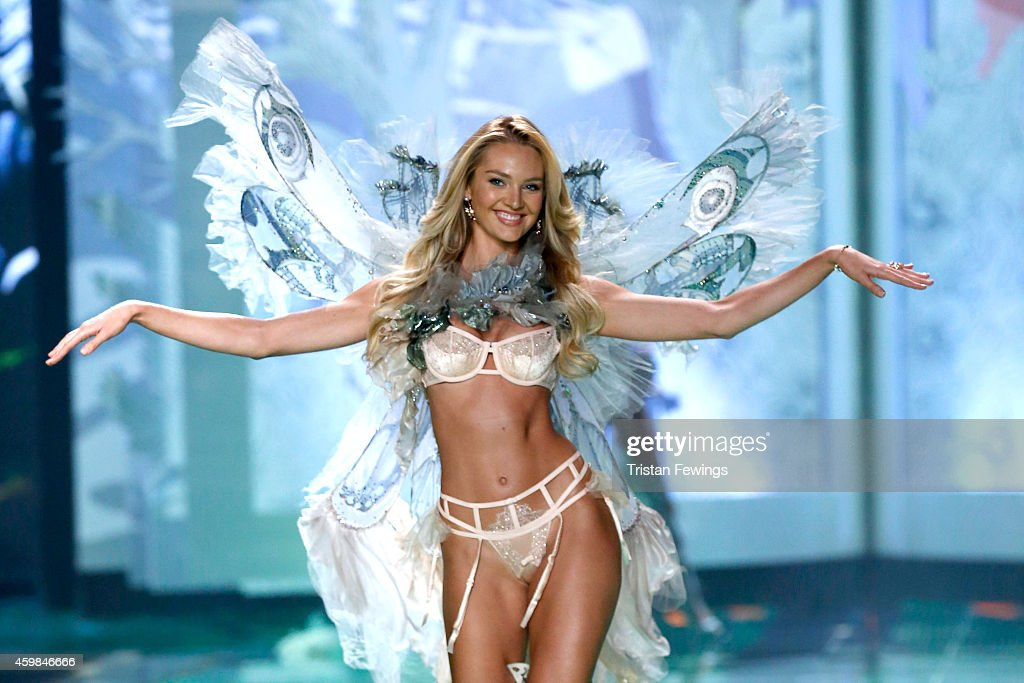 Model <a gi-track='captionPersonalityLinkClicked' href=/galleries/search?phrase=Candice+Swanepoel&family=editorial&specificpeople=4357958 ng-click='$event.stopPropagation()'>Candice Swanepoel</a> wears Victoria's Secret Designer Collection Bra, Garter Belt and Matching Panty with Swarovski crystals, Hand Dyed Tulle and Chiffon Wings and Neck Piece on the runway at the 2014 Victoria's Secret Runway Show - Swarovski Crystal Looks at Earl's Court Exhibition Centre on December 2, 2014 in London, England.