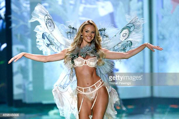 Model Candice Swanepoel wears Victoria's Secret Designer Collection Bra Garter Belt and Matching Panty with Swarovski crystals Hand Dyed Tulle and...
