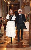 Model Cara Delevigne and Designer Karl Lagerfeld during the Chanel Metiers d'Art Collection 2014/15 ParisSalzburg on December 2 2014 in Salzburg...