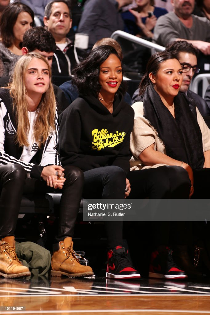 Model Cara Delevingne and Artist Rihanna watch the Brooklyn Nets play the Atlanta Hawks at the Barclays Center on January 6, 2014 in the Brooklyn borough of New York City.