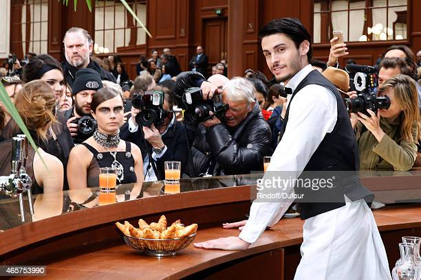 Model Cara Delevingne and Baptiste Giabiconi pose after the Chanel show as part of the Paris Fashion Week Womenswear Fall/Winter 2015/2016 on March...