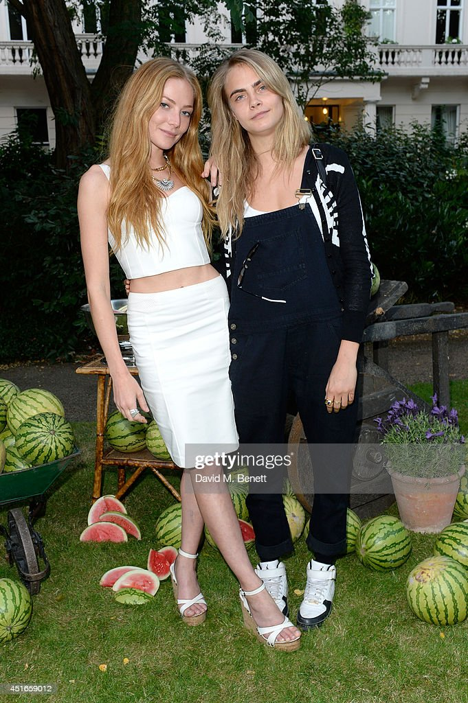 Model <a gi-track='captionPersonalityLinkClicked' href=/galleries/search?phrase=Cara+Delevingne&family=editorial&specificpeople=5488432 ng-click='$event.stopPropagation()'>Cara Delevingne</a> (R) and <a gi-track='captionPersonalityLinkClicked' href=/galleries/search?phrase=Clara+Paget&family=editorial&specificpeople=5939171 ng-click='$event.stopPropagation()'>Clara Paget</a> attend the Club Monaco Garden Party hosted by Quentin Jones, <a gi-track='captionPersonalityLinkClicked' href=/galleries/search?phrase=Clara+Paget&family=editorial&specificpeople=5939171 ng-click='$event.stopPropagation()'>Clara Paget</a> and Annie Morris in Eaton Square on July 3, 2014 in London, England.