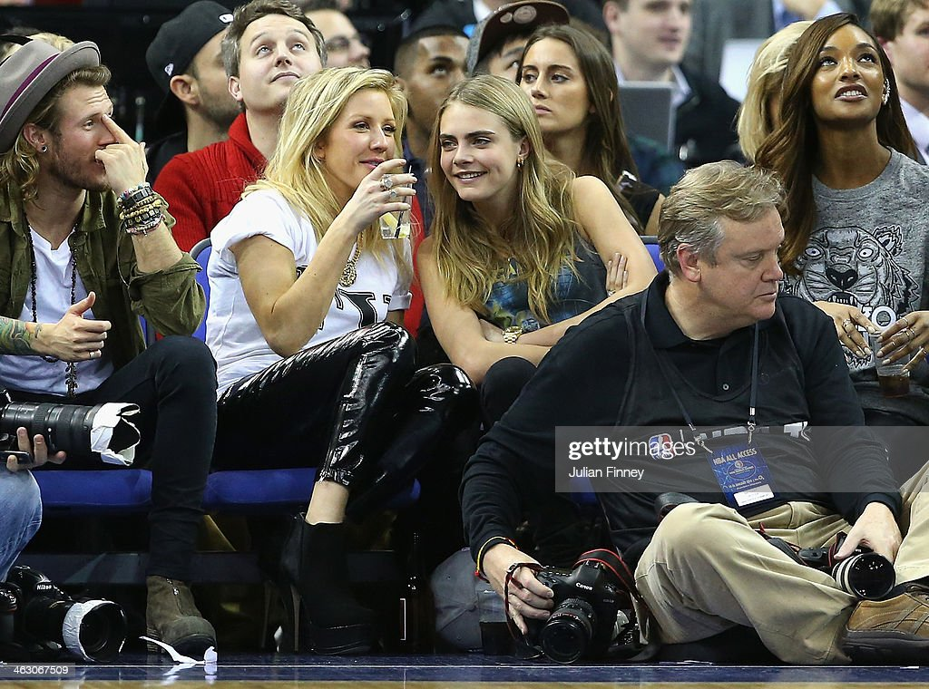Model Cara Delevingne and Ellie Goulding attend the Eastern Conference NBA match between Brooklyn Nets and Atlanta Hawks at O2 Arena on January 16, 2014 in London, England.