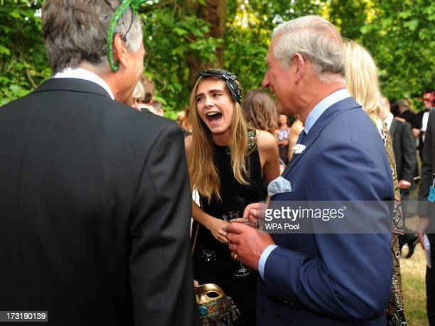 Model Cara Delevingne and family meet with Prince Charles Prince of Wales as they attend a reception hosted by The Prince of Wales and Duchess of...