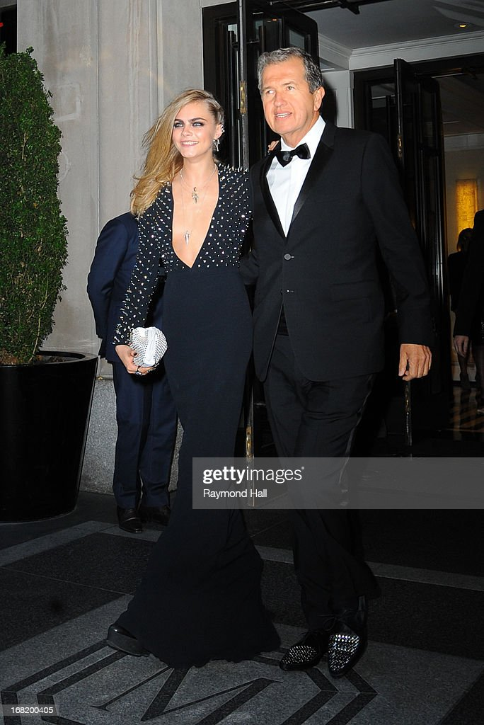 Model Cara Delevingne and photographer Mario Testino depart the Mark Hotel for the 'PUNK: Chaos To Couture' Costume Institute Gala at the Metropolitan Museum of Art on May 6, 2013 in New York City.
