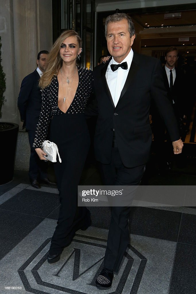 Model Cara Delevingne and Photographer Mario Testino departs the Mark Hotel for the 'PUNK: Chaos To Couture' Costume Institute Gala at the Metropolitan Museum of Art on May 6, 2013 in New York City.
