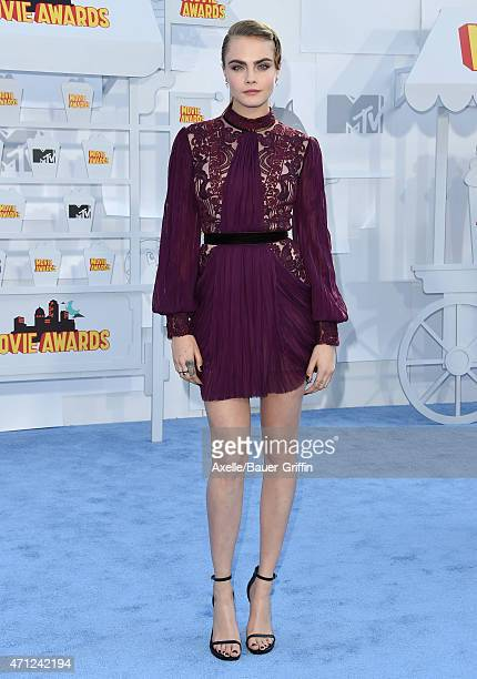 Model Cara Delevingne arrives at the 2015 MTV Movie Awards at Nokia Theatre LA Live on April 12 2015 in Los Angeles California