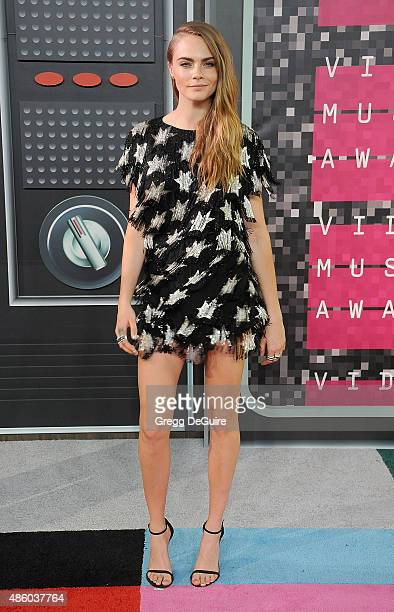 Model Cara Delevingne arrives at the 2015 MTV Video Music Awards at Microsoft Theater on August 30 2015 in Los Angeles California
