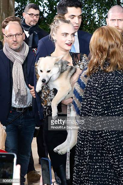 Model Cara Delevingne arrives with a Dog at the Chanel Spring Summer 2016 show as part of Paris Fashion Week on January 26 2016 in Paris France