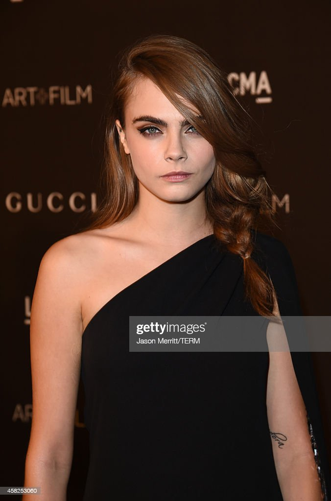 Model <a gi-track='captionPersonalityLinkClicked' href=/galleries/search?phrase=Cara+Delevingne&family=editorial&specificpeople=5488432 ng-click='$event.stopPropagation()'>Cara Delevingne</a> attends the 2014 LACMA Art + Film Gala honoring Barbara Kruger and Quentin Tarantino presented by Gucci at LACMA on November 1, 2014 in Los Angeles, California.