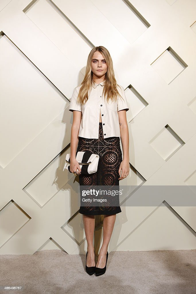 Model <a gi-track='captionPersonalityLinkClicked' href=/galleries/search?phrase=Cara+Delevingne&family=editorial&specificpeople=5488432 ng-click='$event.stopPropagation()'>Cara Delevingne</a> attends the Burberry brings London to Shanghai event on April 24, 2014 in Shanghai, China.