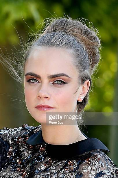 Model Cara Delevingne attends the 'Paper Towns La Face Cachee De Margo' Photocall at the Champs de Mars on June 17 2015 in Paris France