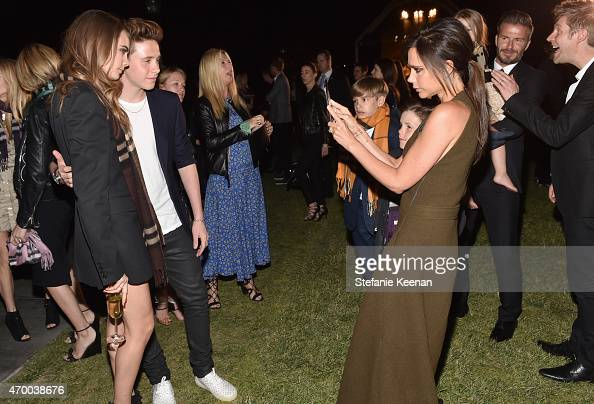 Model Cara Delevingne Brooklyn Beckham and Victoria Beckham attend the Burberry 'London in Los Angeles' event at Griffith Observatory on April 16...