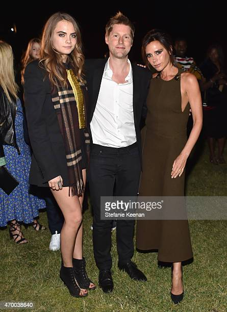 Model Cara Delevingne chief executive chief creative officer of Burberry Christopher Bailey and Victoria Beckham attend the Burberry 'London in Los...