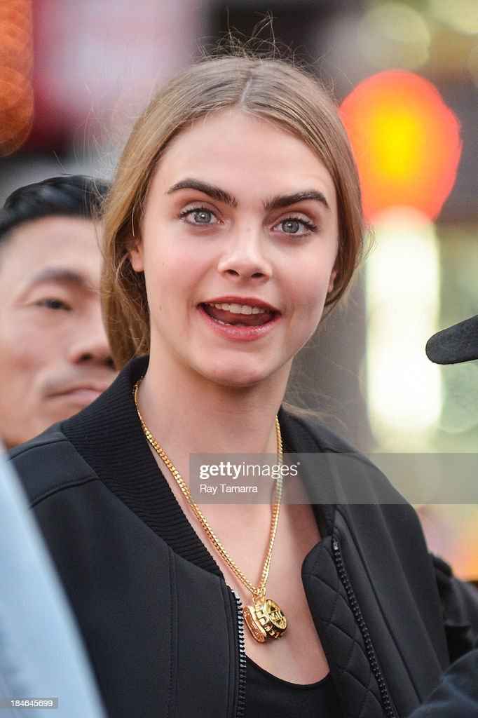Model <a gi-track='captionPersonalityLinkClicked' href=/galleries/search?phrase=Cara+Delevingne&family=editorial&specificpeople=5488432 ng-click='$event.stopPropagation()'>Cara Delevingne</a> enters a DKNY photo shoot in Times Square on October 14, 2013 in New York City.