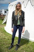 Model Cara Delevingne is pictured during day 4 of the 2013 Glastonbury Festival at Worthy Farm on June 30 2013 in Glastonbury England