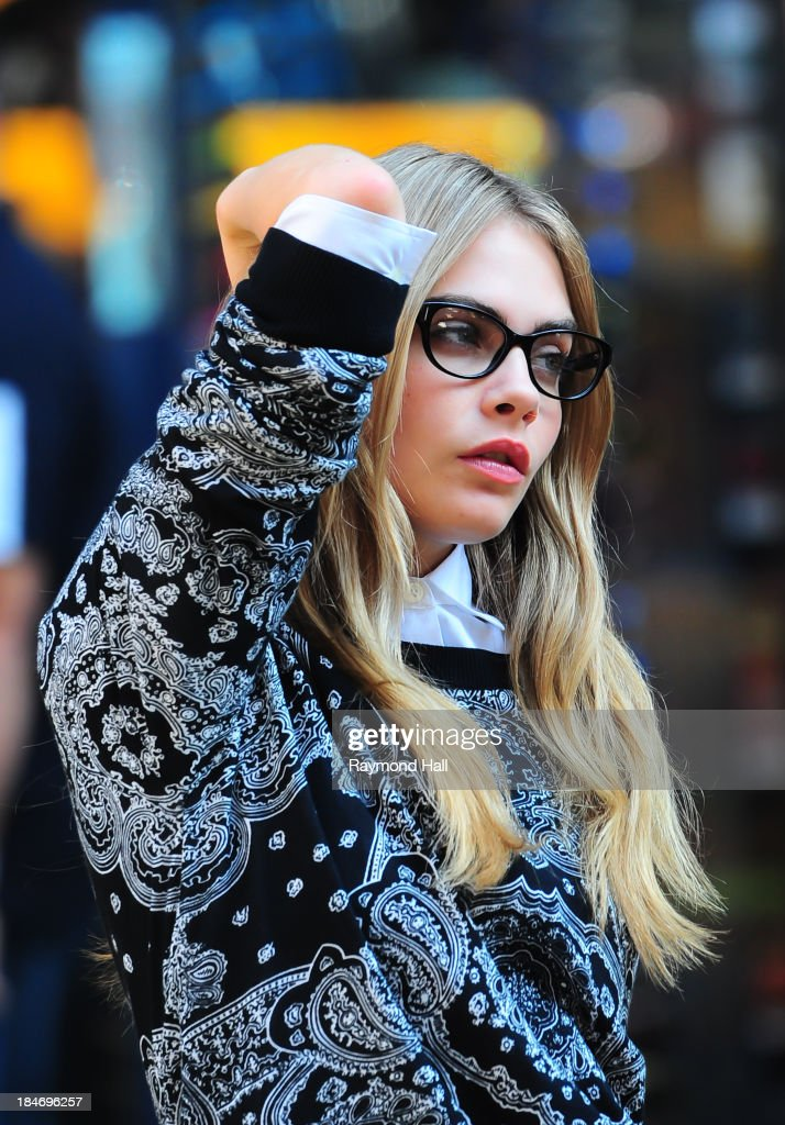 Model <a gi-track='captionPersonalityLinkClicked' href=/galleries/search?phrase=Cara+Delevingne&family=editorial&specificpeople=5488432 ng-click='$event.stopPropagation()'>Cara Delevingne</a> is seen on the set of a DKNY photoshoot on October 15, 2013 in New York City.