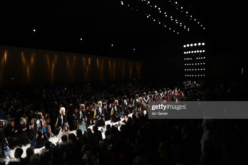 Model <a gi-track='captionPersonalityLinkClicked' href=/galleries/search?phrase=Cara+Delevingne&family=editorial&specificpeople=5488432 ng-click='$event.stopPropagation()'>Cara Delevingne</a> leads the finale on the the runway at Burberry Womenswear Autumn/Winter 2014 at Kensington Gardens on February 17, 2014 in London, England.
