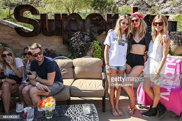 Model Cara Delevingne model Poppy Delevingne and actress Sienna Miller attend the Superdry Coachella brunch hosted by Poppy Delevingne on April 12...