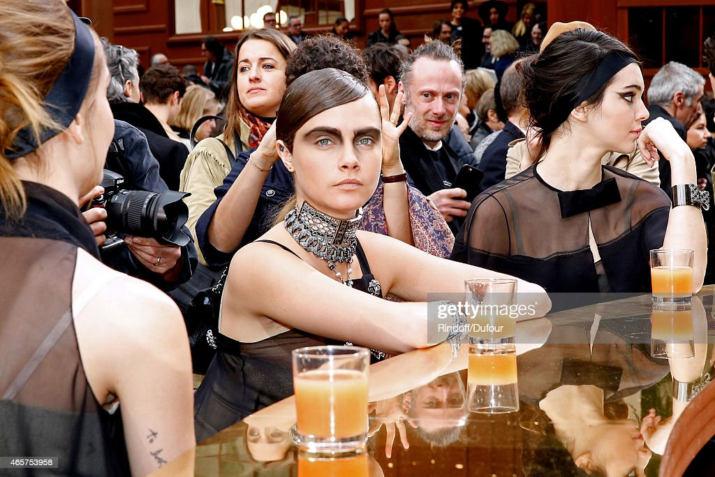 Model Cara Delevingne poses after the Chanel show as part of the Paris Fashion Week Womenswear Fall/Winter 2015/2016 on March 10 2015 in Paris France