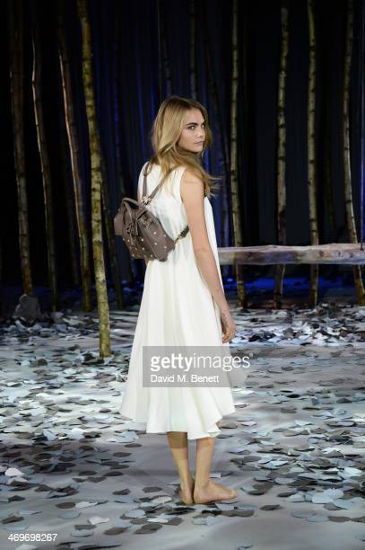 Model Cara Delevingne poses at a photocall to launch the Mulberry Cara Delevingne Collection during London Fashion WeekDB at Claridge's Hotel on...