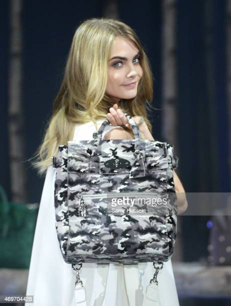 Model Cara Delevingne poses at a photocall to launch the Mulberry Cara Delevingne Collection during London Fashion Week at Claridge's Hotel on...
