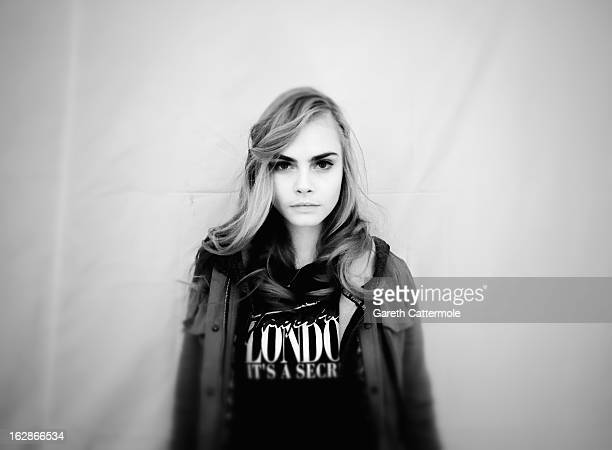 Model Cara Delevingne poses backstage before the HM Fall/Winter 2013 ReadytoWear show as part of Paris Fashion Week on February 27 2013 in Paris...