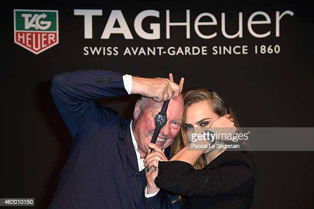 Model Cara Delevingne poses with JeanClaude Biver as she joins TAG Heuer as Brand Ambassador to launch the new 2015 campaign at Palais des BeauxArts...