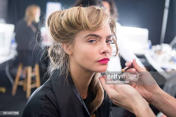 Model Cara Delevingne prepares backstage at Diane Von Furstenberg during Fall 2013 MercedesBenz Fashion Week at The Theatre at Lincoln Center on...