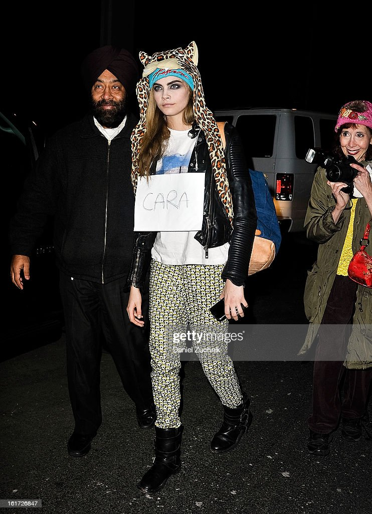 Model <a gi-track='captionPersonalityLinkClicked' href=/galleries/search?phrase=Cara+Delevingne&family=editorial&specificpeople=5488432 ng-click='$event.stopPropagation()'>Cara Delevingne</a> seen outside the Marc Jacobs show on February 14, 2013 in New York City.